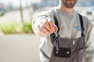 photo of person holding car key after inspection